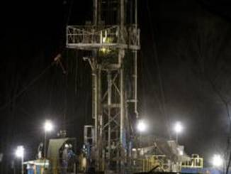 shale gas well operates at night in Moshannon State Forest in Clearfield County, Pa. Twenty states including Pennsylvania have shale gas wells, rigs that tap rock layers harboring gas in shale formations.
